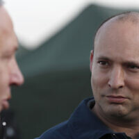 In this November 24, 2019, photo, Defense Minister Naftali Bennett (right) and Prime Minister Benjamin Netanyahu visit an army base in the Golan Heights, on the Israeli-Syrian border. (Atef Safadi/Pool via AP)