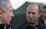 In this Sunday, November 24, 2019 photo, Defense Minister Naftali Bennett and Prime Minister Benjamin Netanyahu visit an Israeli army base in the Golan Heights, on the Israeli-Syrian border. (Atef Safadi/Pool via AP, File)