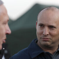 In this Sunday, November 24, 2019 photo, then-defense minister Naftali Bennett and Prime Minister Benjamin Netanyahu visit an Israeli army base in the Golan Heights, on the Israeli-Syrian border. (Atef Safadi/Pool via AP, File)