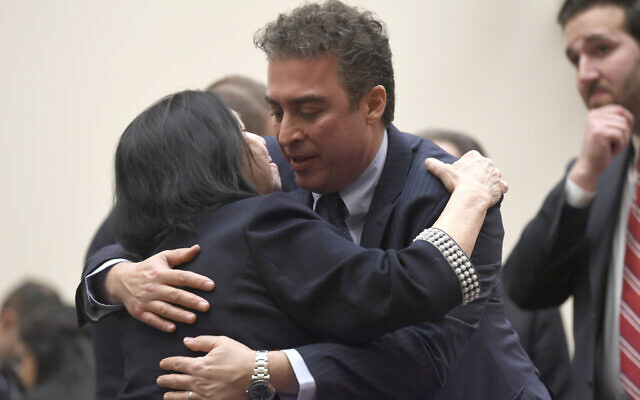 Christine Levinson, wife of Robert Levinson, a former FBI agent who vanished in Iran in 2007, left, gets a hug from Babak Namazi, right, the son of Baquer Namazi who has been held in Iran, following their testimony before a House Foreign Affairs Subcommittee on Capitol Hill in Washington, March 7, 2019. (AP Photo/Susan Walsh, File)
