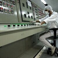 An Iranian technician works at the Uranium Conversion Facility just outside the city of Isfahan, Iran. February 3, 2007. (AP Photo/Vahid Salemi, File)