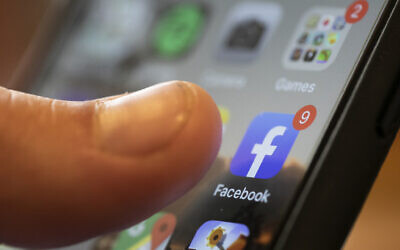 An iPhone displays the Facebook app
