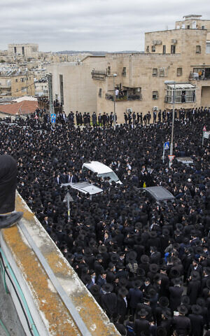 Thousands of ultra-Orthodox Jews participate in funeral for prominent rabbi Meshulam Dovid Soloveitchik, in Jerusalem, January 31, 2021. (AP/Ariel Schalit)