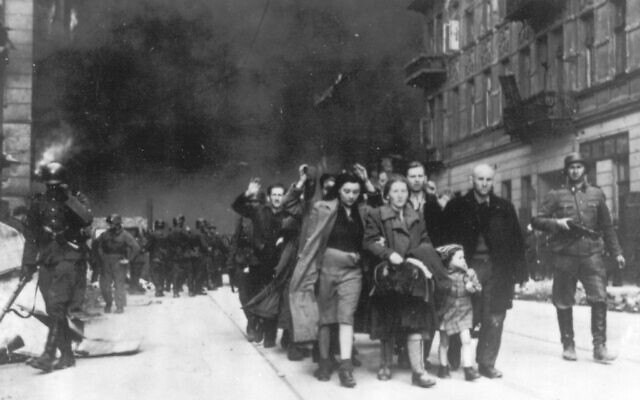 A group of Polish Jews are led away for deportation by German SS soldiers, during the destruction of the Warsaw Ghetto by German troops after an uprising in the Jewish quarter, in 1943. (AP Photo)
