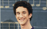 """This image released by NBC shows actor Dustin Diamond as Samuel Powers, better known as Screech"""" from the 1990's series """"Saved by the Bell."""" Diamond died Monday after a three-week fight with carcinoma, according to his representative. He was 44. Diamond was hospitalized last month in Florida and his team disclosed later he had cancer. (Paul Drinkwater/NBCU Photo Bank via AP)"""