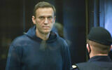 Russian opposition leader Alexei Navalny stands in a class cage during a hearing in the Moscow City Court in Moscow, Russia, February 2, 2021. (Moscow City Court via AP)