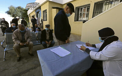 In this February 3, 2021, photo, a man registers to get the COVID-19 vaccine, in Algiers, Algeria. (AP/Fateh Guidoum)
