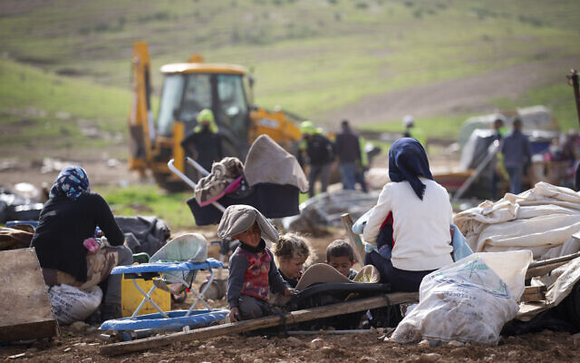In this Feb. 3, 2021, file, photo, Palestinian Bedouin watch Israeli troops demolish tents and other structures of the Khirbet Humsu hamlet in the Jordan Valley in the West Bank (AP Photo/Majdi Mohammed)