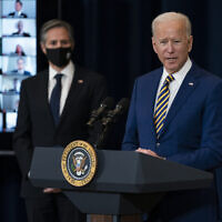 US Secretary of State Antony Blinken (L) listens as US President Joe Biden delivers remarks to State Department staff, February 4, 2021, in Washington. (AP Photo/Evan Vucci)