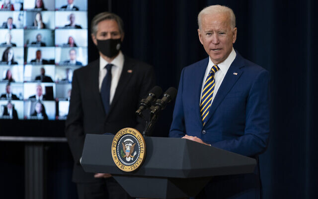 Secretary of State Antony Blinken (L) listens as US President Joe Biden delivers remarks to State Department staff, February 4, 2021, in Washington. (AP Photo/Evan Vucci)