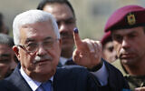 In this October 20, 2012, photo, Palestinian Authority President Mahmoud Abbas shows his ink-stained finger after casting his vote during local elections at a polling station in the West Bank city of Ramallah. (AP/Majdi Mohammed)