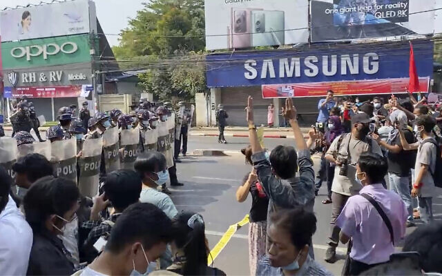 In this screenshot, riot police block the road to prevent protesters from marching forward. on February 6, 2021, in Yangon, Myanmar. (AP Photo)