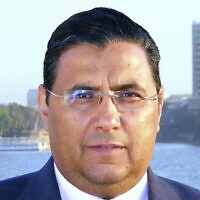 This undated photo provided by Al-Jazeera shows journalist Mahmoud Hussein in Cairo, Egypt (Al-Jazeera via AP, File)