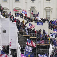 Rioters loyal to US President Donald Trump storm the US Capitol in Washington, January 6, 2020. (AP Photo/John Minchillo, File)