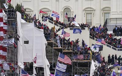 Rioters loyal to US President Donald Trump storm the US Capitol in Washington, January 6, 2020. (AP Photo/John Minchillo, File)