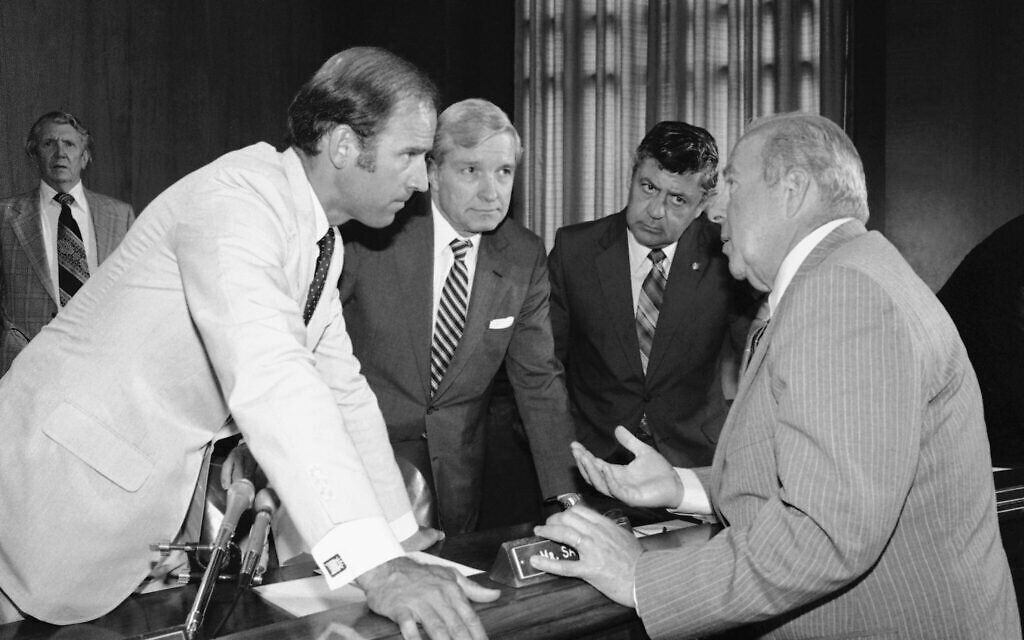 In this July 13, 1982, file photo Secretary of State designate George Shultz, right, speaks with members of the Senate Foreign Relations Committee prior to the start of the afternoon session of the panel on Capitol Hill in Washington. From left are, Sen. Joseph Biden, D-Del.; Sen. Charles Percy, R-Ill., chairman of the panel and Sen. Edward Zorinsky, D-Neb. (AP Photo/Ira Schwarz, File)