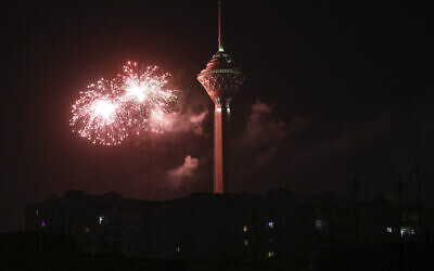 Fireworks explode next to Milad telecommunications tower during celebrations marking the 42nd anniversary of Iran's Islamic Revolution, in Tehran, Iran, February 9, 2021. (Vahid Salemi/AP)