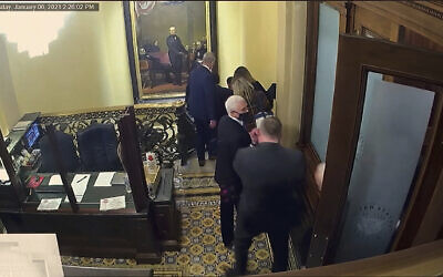 In this image from video, a security video shows Vice President Mike Pence being evacuated as rioters breach the Capitol, as House impeachment manager Del. Stacey Plaskett, D-Virgin Islands, speaks during the second impeachment trial of former President Donald Trump in the Senate at the U.S. Capitol in Washington, Wednesday, Feb. 10, 2021. (Senate Television via AP)