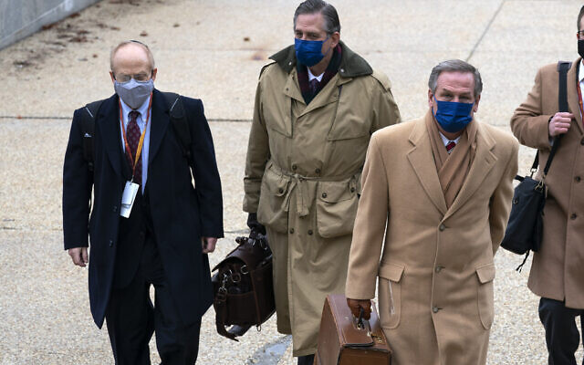 From left: David Schoen, Bruce Castor and Michael van der Veen, lawyers for former US president Donald Trump, arrive at the Capitol on the third day of the second impeachment trial of Trump in the Senate, February 11, 2021, in Washington. (AP Photo/Jose Luis Magana)
