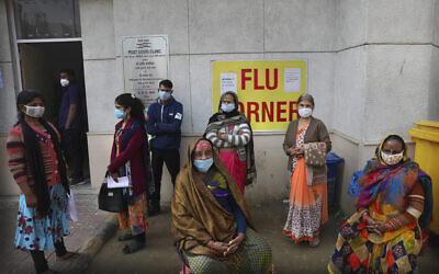 People wait outside a health center to get tested for coronavirus in New Delhi, India, February 11, 2021. (AP Photo/Manish Swarup)