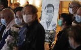 In this Feb. 7, 2020 file photo, people wearing masks attend a vigil for Chinese doctor Li Wenliang, in Hong Kong. The outpouring of grief and rage sparked by Li's death was an unusual - and for the Chinese Communist Party, unsettling - display in China's tightly monitored civic space. (AP Photo/Kin Cheung, File)