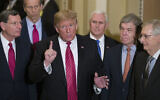 In this Wednesday, Jan. 9, 2019 file photo, Sen. John Barrasso, R-Wyo., left, and Sen. John Thune, R-S.D., stand with President Donald Trump, Vice President Mike Pence, Sen. Roy Blunt, R-Mo., and Senate Majority Leader Mitch McConnell of Ky., as Trump speaks while departing after a Senate Republican Policy luncheon, on Capitol Hill in Washington.  (AP Photo/Alex Brandon, File)