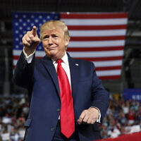 Then-US president Donald Trump gestures to the crowd as he arrives to speak at a campaign rally at Williams Arena in Greenville, NC, July 17, 2019. (AP Photo/Carolyn Kaster, File)