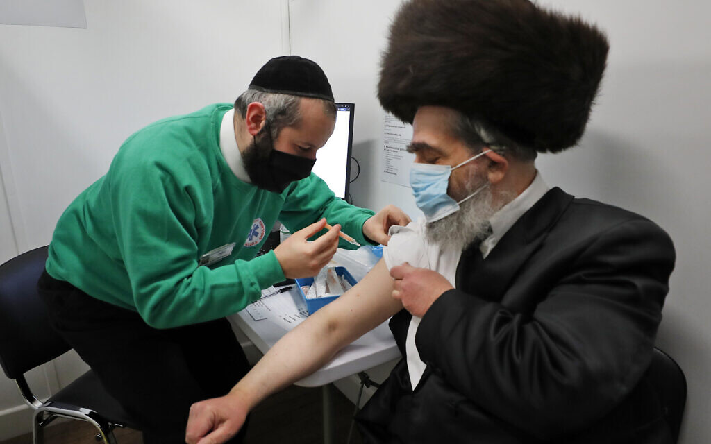 Ultra-Orthodox Londoners roll up sleeves to fight COVID - The Times of Israel