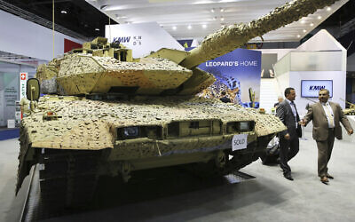 """Illustrative: Men walk past a Krauss-Maffei Wegmann Leopard tank with a """"sold"""" sign on it at the International Defense Exhibition and Conference, known by the acronym IDEX, in Abu Dhabi, United Arab Emirates, February 22, 2017 (AP Photo/Jon Gambrell, File)"""