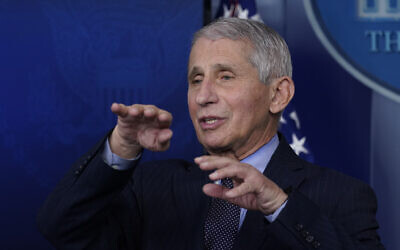 Dr. Anthony Fauci, director of the National Institute of Allergy and Infectious Diseases, speaks with reporters at the White House, in Washington, January 21, 2021 (AP Photo/Alex Brandon, File)