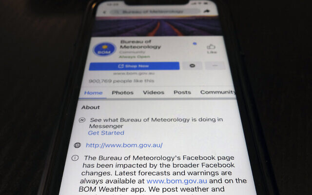 A disclaimer is shown on the bottom of Australia's Bureau of Meteorology page on the Facebook app, February 18, 2021, in Tokyo. (AP Photo/Kiichiro Sato)