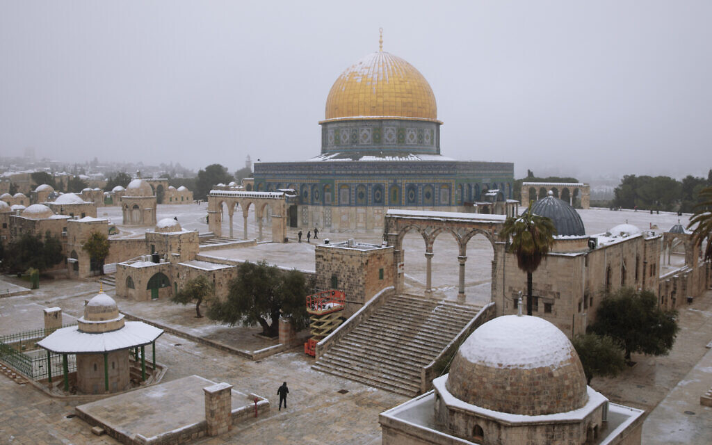 Snow dusts the Dome of the Rock atop the Temple Mount in the Old City of Jerusalem, Thursday, Feb. 18, 2021. (AP Photo/Oded Balilty)