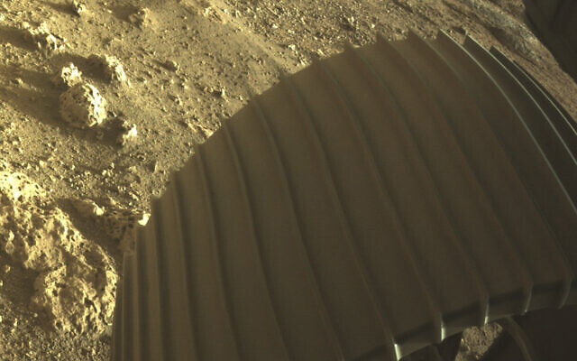 This photo provided by NASA shows one of the six wheels on the Perseverance Mars rover, which landed on Thursday, Feb. 18, 2021. (NASA/JPL-Caltech via AP)