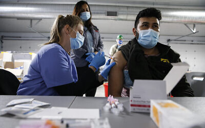 Tyson Foods team members receive COVID-19 vaccines from health officials at the Joslin, Illinois facility, February 19, 2021. (John Konstantaras/AP Images for Tyson Foods)