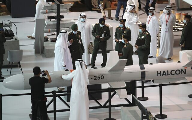 A military delegation visit the display of  Halcon, a regional leader in the end-to-end manufacturing of precision-guided systems, during the opening day of the International Defence Exhibition and Conference, IDEX, in Abu Dhabi, United Arab Emirates, February 21, 2021. (Kamran Jebreili/AP)