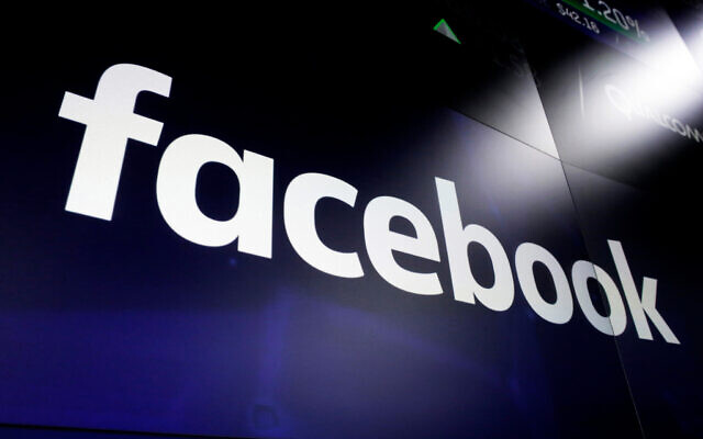 The Facebook logo on screens at the Nasdaq MarketSite, in New York's Times Square, on March 29, 2018. (AP Photo/ Richard Drew/ File)