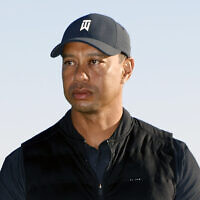 File: Tiger Woods looks on during the trophy ceremony on the practice green after the final round of the Genesis Invitational golf tournament at Riviera Country Club on Feb. 21, 2021, in the Pacific Palisades area of Los Angeles. (AP/Ryan Kang)