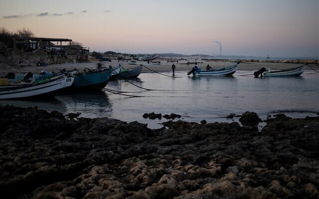 Fishermen unload their nets after returning from a fishing trip on the Mediterranean Sea, in the Israeli Arab village of Jisr az-Zarqa, in the early morning of Thursday, Feb. 25, 2021 (AP Photo/Ariel Schalit)