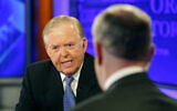 """Lou Dobbs, left, speaks with Bill O'Reilly during taping a segment for Fox News channel's """"The O'Reilly Factor,"""" in New York, November 16, 2009.  (AP/Kathy Willens)"""