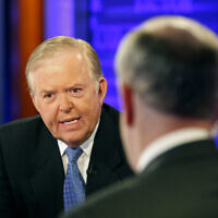 "Lou Dobbs, left, speaks with Bill O'Reilly during taping a segment for Fox News channel's ""The O'Reilly Factor,"" in New York, November 16, 2009.  (AP/Kathy Willens)"