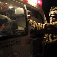 Illustrative: A wounded Israeli soldier is evacuated by ambulance on the Israel-Gaza border in southern Israel, November 10, 2012. (AP Photo/Tsafrir Abayov)
