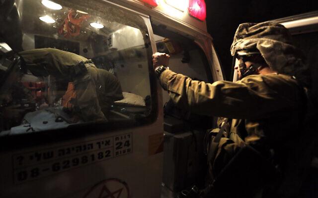 Illustrative: A wounded Israeli soldier is evacuated by ambulance on the Israel-Gaza border in southern Israel, November 10, 2012. (AP Photo/Tsafrir Abayov)