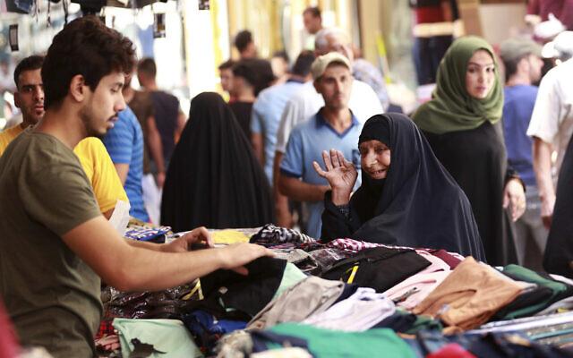 Illustrative: Iraqis shop for Eid al-Fitr at the Shorjah market in central Baghdad, Iraq, Wednesday, June 21, 2017. (AP Photo/Hadi Mizban)
