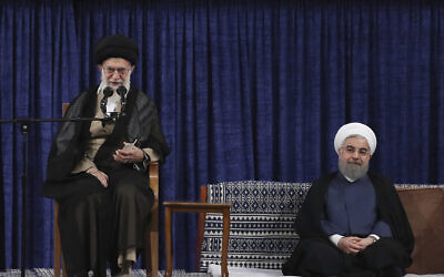 Iranian supreme leader Ayatollah Ali Khamenei, left, speaks during the official endorsement ceremony of President Hassan Rouhani, right, in Tehran, Iran, Thursday, Aug. 3, 2017. (Iranian Presidency Office via AP)