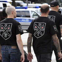 Far-right extremists gather to commemorate the death of Adolf Hitler's deputy, Rudolf Hess, in Berlin's western district  of Spandau,  Aug. 19, 2017 (Maurizio Gambarini/dpa via AP)