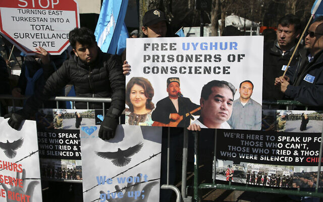 Illustrative: In this March 15, 2018, file photo, Uighurs and their supporters rally across the street from United Nations headquarters in New York. Members of the Uighur Muslim ethnic group are calling on China to post videos of their relatives who have disappeared into a vast system of internment camps. The campaign follows the release of a state media video showing famed Uighur musician Abdurehim Heyit, who many believed had died in custody. (AP Photo/Seth Wenig, File)