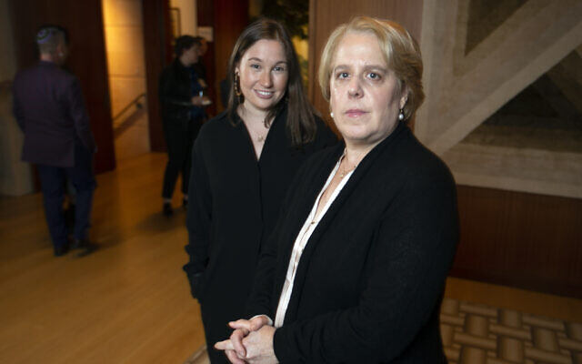Roberta Kaplan, right, a lead lawyer in Sines v. Kessler, and Amy Spitalnick, executive director of Integrity First for America, the nonprofit funding the lawsuit, pose for a photo in Atherton Calif., Tuesday, Nov. 12, 2019 (AP Photo/D. Ross Cameron)