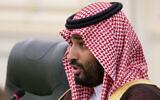In this October 14, 2019 file photo, Saudi Arabia's Crown Prince Mohammed bin Salman speaks to Russian President Vladimir Putin during the talks in Riyadh, Saudi Arabia. (AP Photo/Alexander Zemlianichenko, Pool, File)