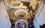 Technicians work at the Arak heavy water reactor's secondary circuit, as officials and media visit the site, near Arak, 150 miles (250 kilometers) southwest of the capital Tehran, Iran, Monday, Dec. 23, 2019. (Atomic Energy Organization of Iran via AP)