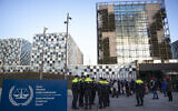Police escort a group of supporters of former Ivory Coast president Laurent Gbagbo outside the International Criminal Court in The Hague, Netherlands, Thursday, February 6, 2020. (AP/Peter Dejong)